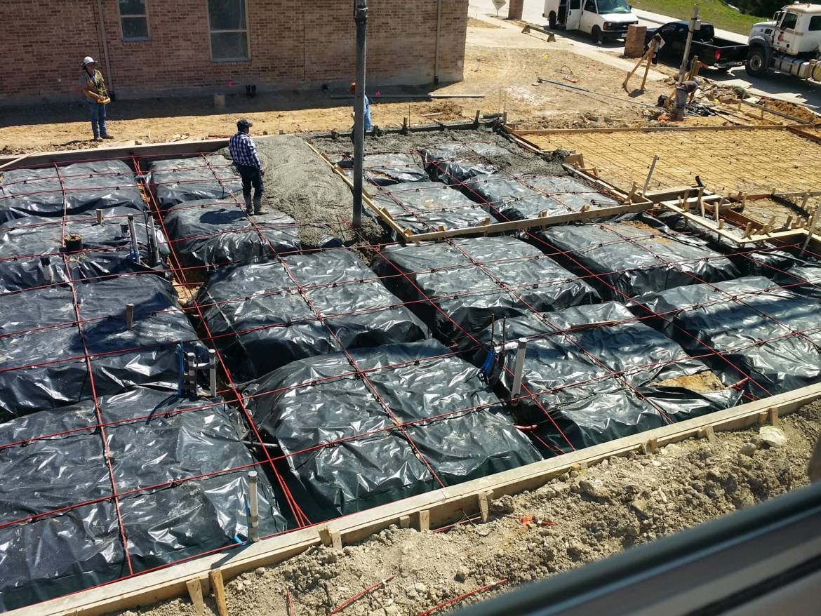 concrete-foundation-being-poured_20150327_130454.jpg