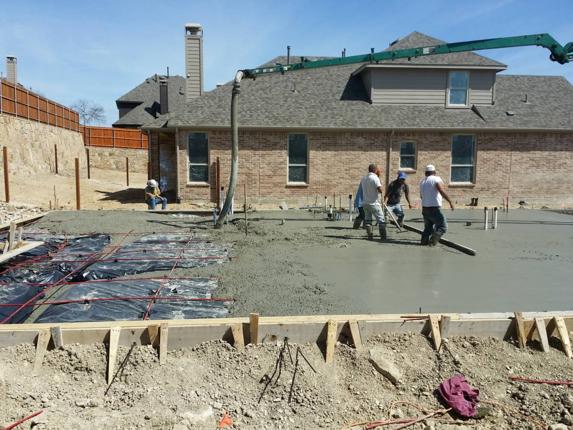 concrete-foundation-being-poured_20150327_150734.jpg